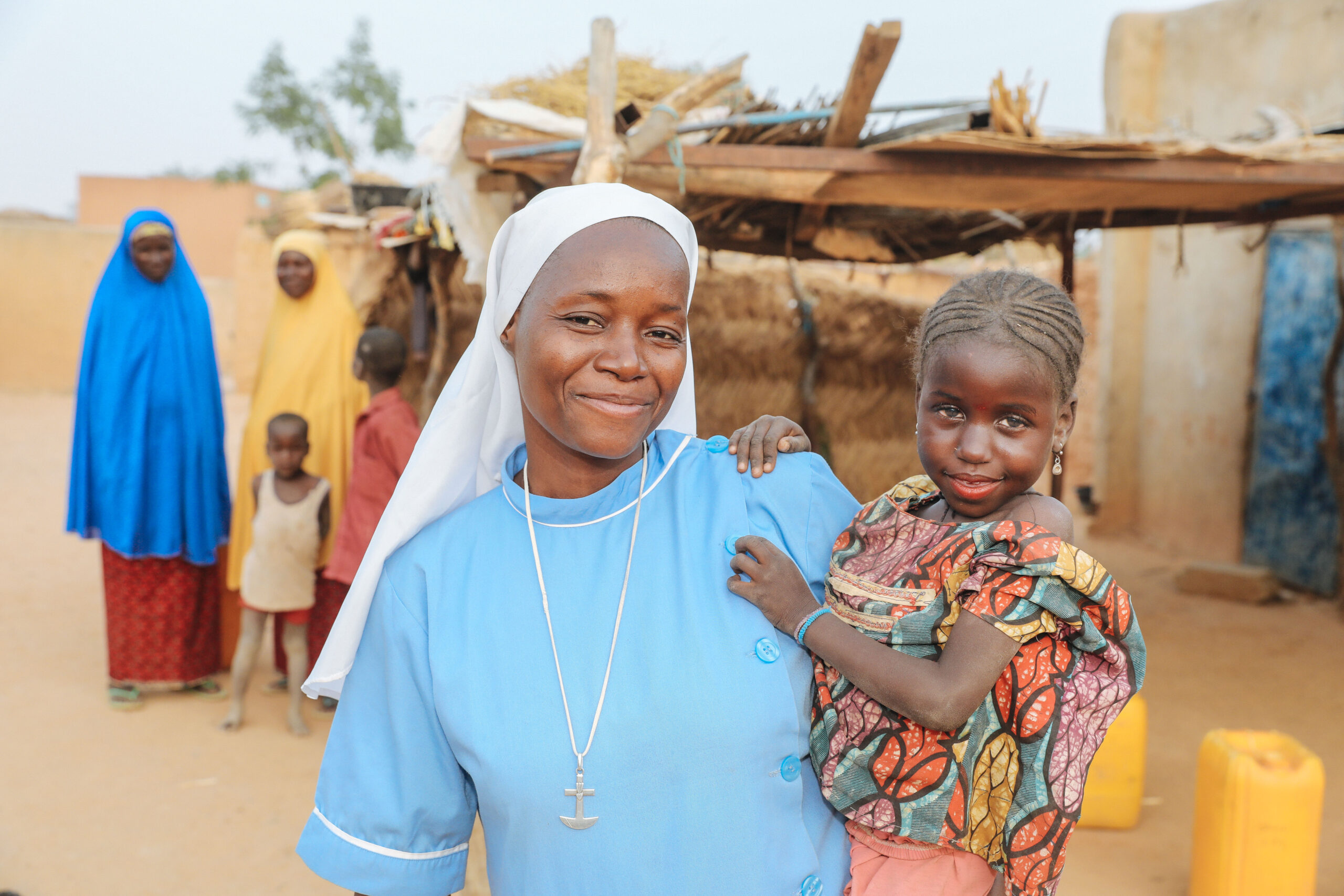 Image of Sr Félicité Sampo holding a small child